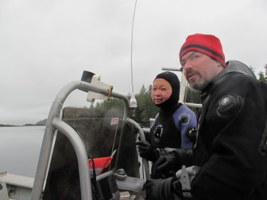 Lee (left) and Vigneault working in Haida Gwaii weather