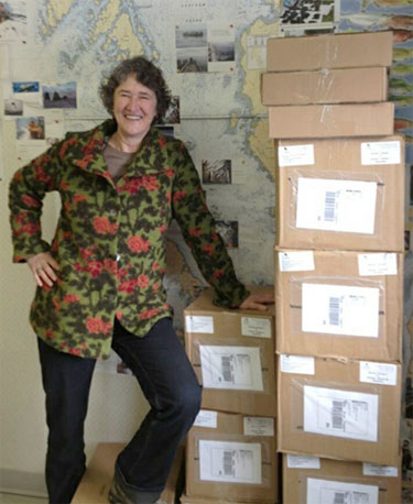 Rina Gemeinhardt with boxes of paperwork from one project referral