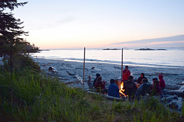 High school students learn traditional skills on a SEAS Outdoors Club camping trip to Goose Island in Heiltsuk territory. Photo credit: Johanna Gordon-Walker.