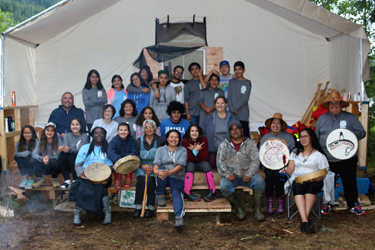 A group shot from the Haisla Youth Camp, showing the youth, support staff, and members of the Spirit of Kitlope dance group. Photo credit: Brenda Bouzane.