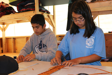 Youth learned how to weave cedar. Photo credit: Brenda Bouzane.