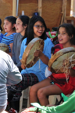 Guests from Spirit of the Kitlope dance group taught the youth traditional drumming songs. Photo credit: Brenda Bouzane.